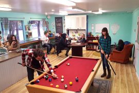 neo youth center playing pool