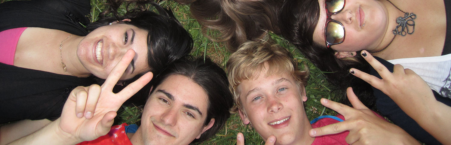 group of teens lying on lawn